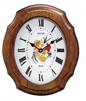 horloge murale ovale entrourage ch ne d co centrale fleurs 1001 pendules. Black Bedroom Furniture Sets. Home Design Ideas